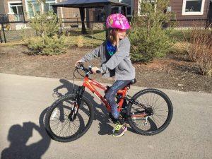Zoe riding a bike