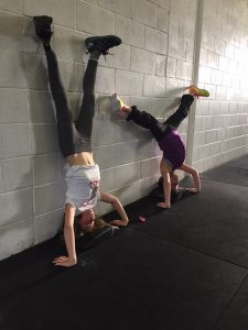 Zoe and friend doing a hand stand