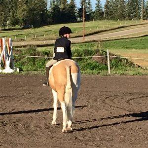 Zoe riding a horse