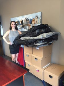 Image of Deanna Gilbert with boxes of clothes donated to Dress for Success Toronto 2016