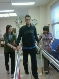 Image of Nicholas Morihovitis on day 8 of his rehab with parallel bars