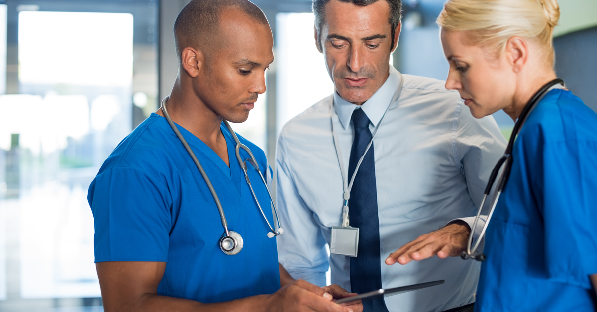 health care professionals consulting with each other