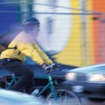 cyclist driving in traffic