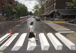 lady crossing 3d crosswalk in montreal