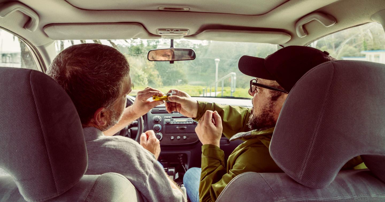 driver and passenger smoking marijuana in car