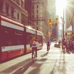 cyclist riding alongside Toronto streetcar